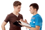 Young man explains God's Word to his friend